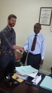 Justin Gradek & Dr. Eria Hisali, Dean of the College of Business and Management Sciences at Makerere University