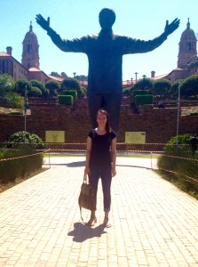 Kara Coughlin stands in front of the Nelson Mandela statue in South Africa