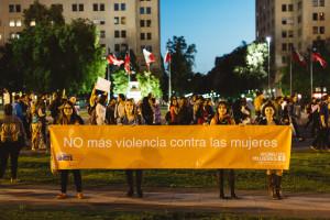 Carla Nodi (far right) holding up a UN women Sign in Santiago