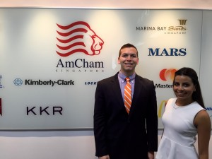 Joshua Klein in front of AmCham Singapore logo