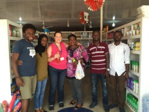 SU students (from L-R) Francis Morency, Hatou Camara, and Emily Hoerner with IOM Reintegration Assistant Doris Ohene-Kankam and IOM AVRR (Assisted Voluntary Return and Reintegration) beneficiary Nelson Amtwi. This photo was taken after an interview with Amtwi at his convenience store in Spintex, just outside Accra.