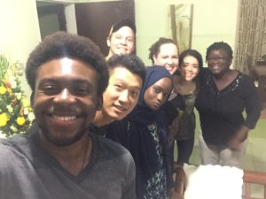 SU students (from L-R) Francis Morency, Jinpu Wang, Sam Connors, Hatou Camara, Emily Hoerner, and Alison Rivera with EMPA alum Erika at her home near the University of Ghana.