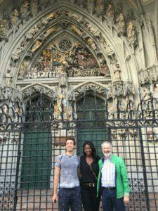 Ivan Zhivkov, Janessa Price, and Program Director Werner Schleiffer at the Berner Munster (Bern Cathedral), Bern, Switzerland