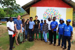 Community volunteers, members, and Syracuse University students (starting 2nd from left): Sam Connors, Hatou Camara, Alison Rivera, Francis Morency, Jinpu Wang) in front of the tree of life community painting