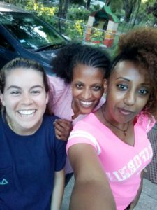 Sarah Baumunk with a couple of Casa residents, who are both asylees from Eritrea
