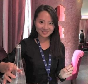 Suhyeon Lee with her IOM badge at a restaurant in Geneva