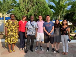 Askar Salikhov, Jingxuan Wang, and Esther Chung pose for a photograph with project managers Akpene Amenumey and Victoria Klimova, project assistant Daniel Tagoe, and IOM intern Bowie Ko on the last day of the internship