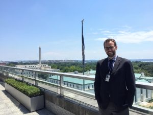 Bart Kassel atop one of the State Department buildings in Washington, D.C.