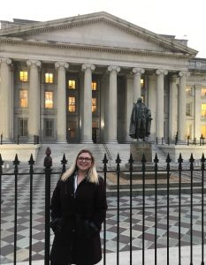 Lauren Sutkus in front of the Treasury building
